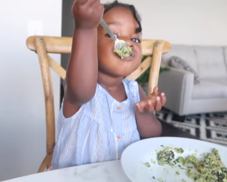 Kid eating with a spoon