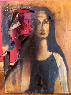 Photo of a painting damaged by fire