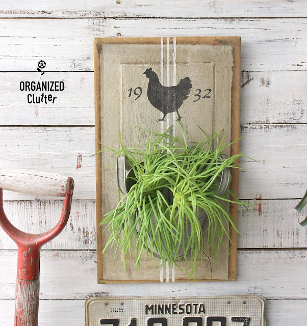 An Easy DIY Wall Planter Created from A Salvaged Cabinet Panel #stencil #Oldsignstencils #cabinetpanel #farmhouse #farmhousestyle #wallpocket #grainsackstripe