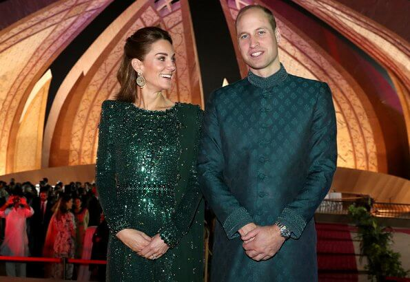 Kate Middleton wore a sparkling emerald green gown by Jenny Packham, and earrings by O'nita. Prince William wore a traditional Sherwani by Naushemian