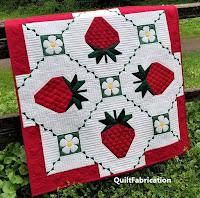 Strawberry Splendor quilt by QuiltFabrication