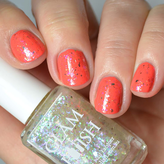 blue purple flakie nail polish swatched over orange