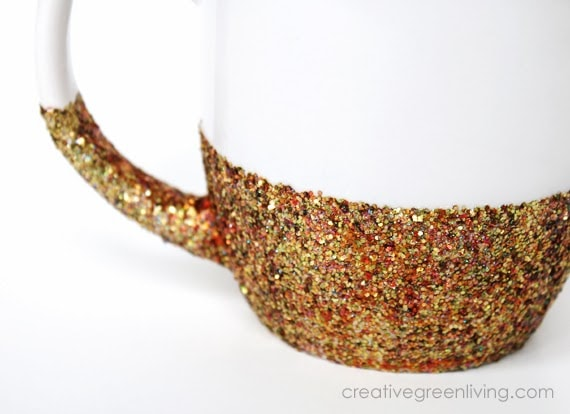Homemade DIY glitter dipped mug made with gold glitter