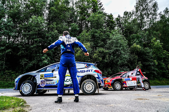 Rally drivers limbering up before stage start