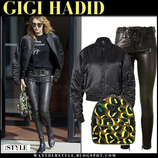 Gigi Hadid in black kith bomber jacket, black leather pants with yellow leopard print versace backpack what she wore model style