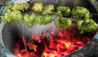 Cooking hariyali kabab over a charcoal tandoor