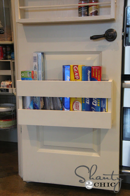 Utilize the back of a pantry door for kitchen supplies