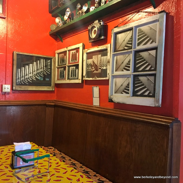 work of artist Suzy Kuhr hangs in her Smart Pizza parlor in Guerneville, California