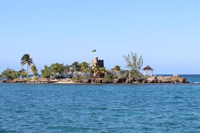 """Figure: """"Don't worry, about a thing."""" Can you spot the flag flying high on this island?"""