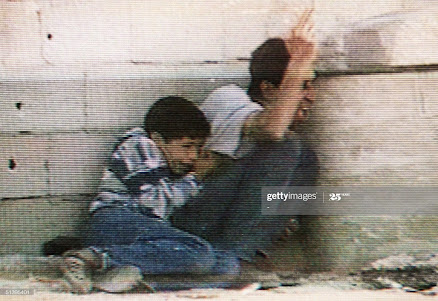 "The last moments of Mohamed El-Dorra where his father tried to protect him ""AFP"""