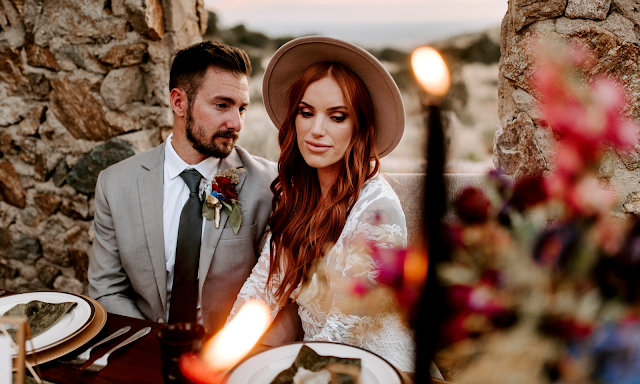 bohemian bride with hat and lace dress candlelight