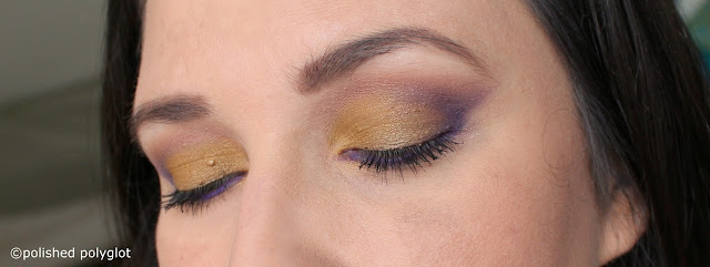 Makeup look in mustard yellow and purple