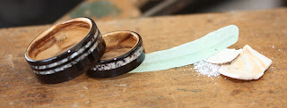 Blackwood rings with Bethlehem Olive wood interiors and inlaid with crushed shell and sea glass.