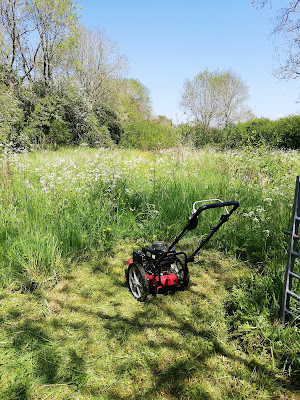 Cutting the grass at Turnditch Orchard