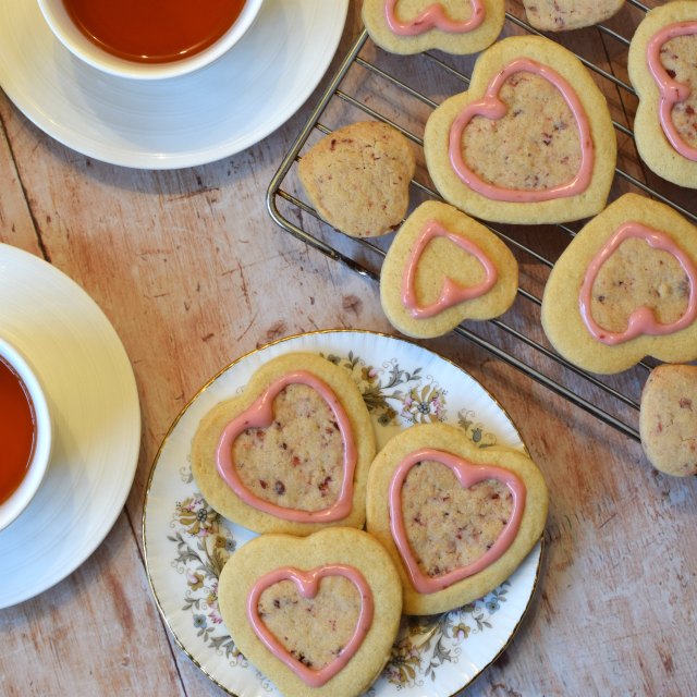 Valentine Shortbread cookies, shaped in a heart with a pretty pink strawberry icing which is naturally coloured with jam.