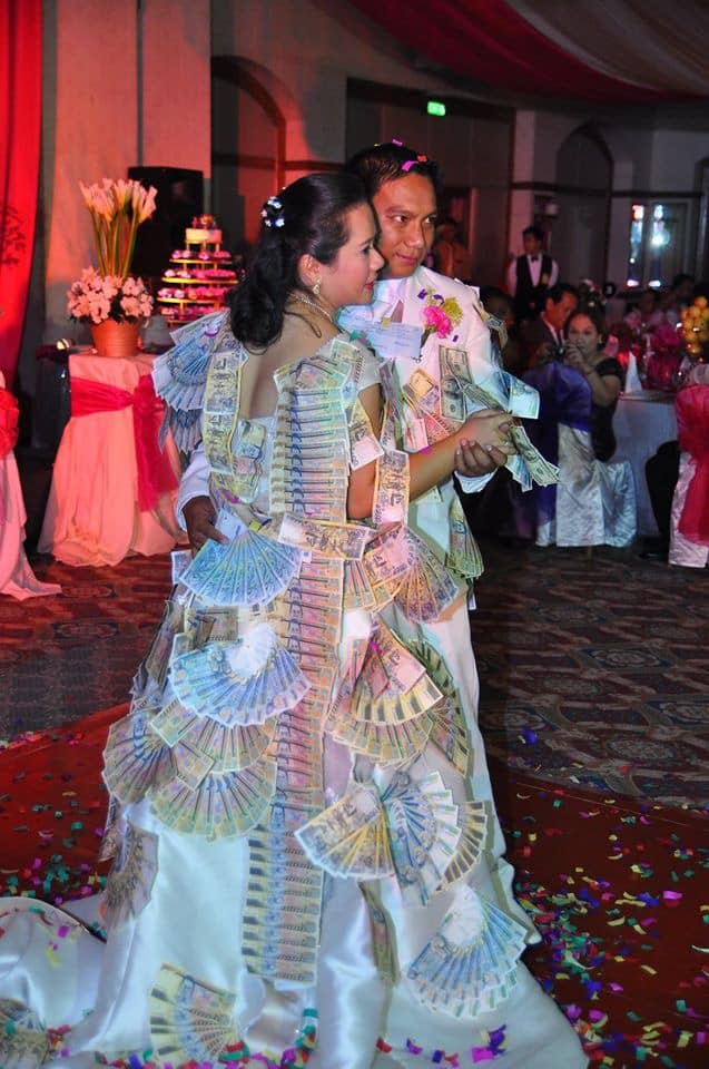 Couple goes viral for getting Php629,000 at their wedding's prosperity dance
