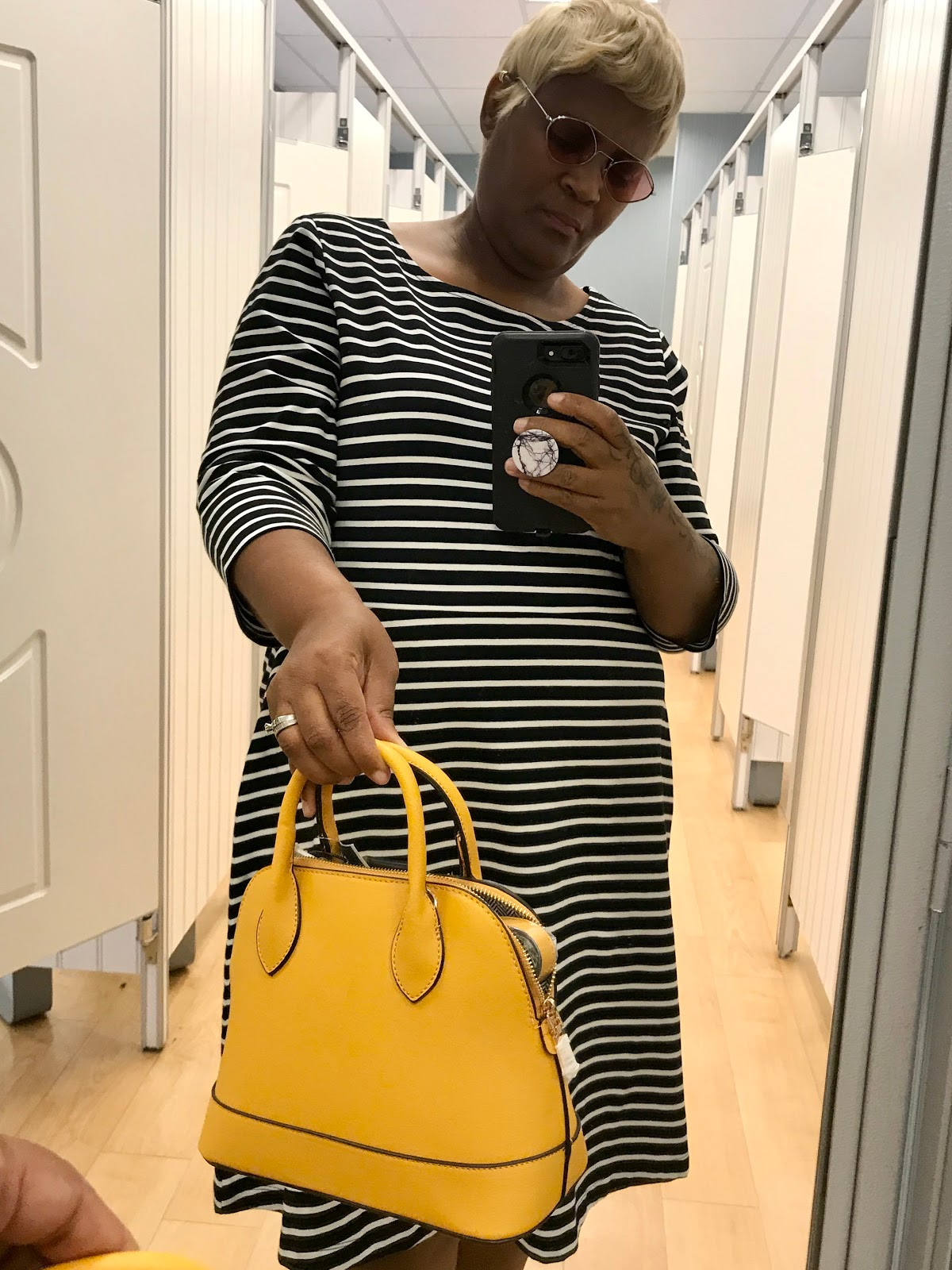 Image: Tangie Bell trying on stripe dress with yellow handbag for her birthday. Seen first on Bits and Babbles blog. Its a try-on haul