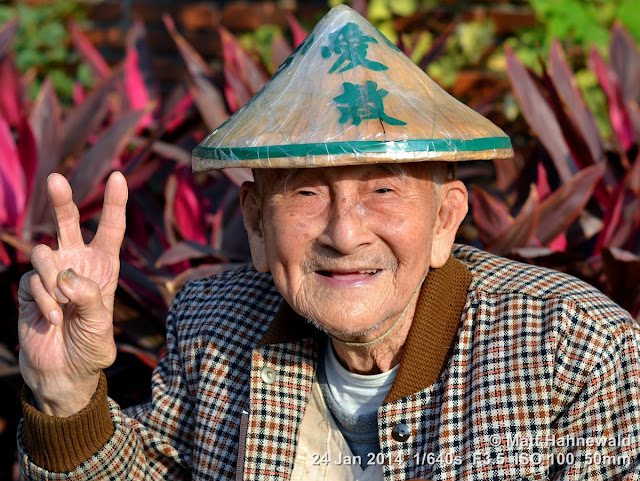 Asian conical hat, conical straw hat, sedge hat, rice hat, paddy hat, Taiwanese old woman with conical hat, portrait, Taiwan, Kaohsiung, V sign