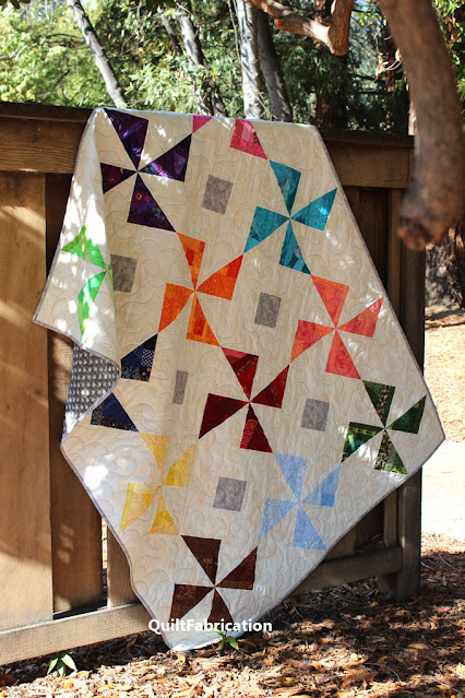 12 colors of pinwheels in a quilt by QuiltFabrication