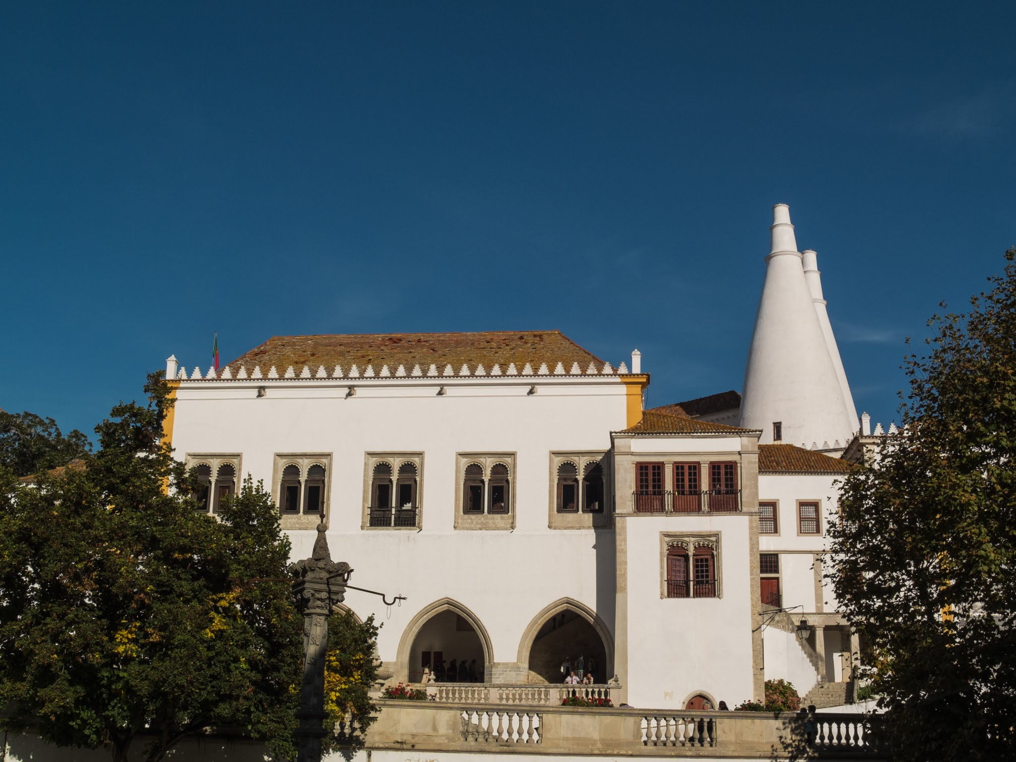 View of the National Palace of Sintra against a blue sky.