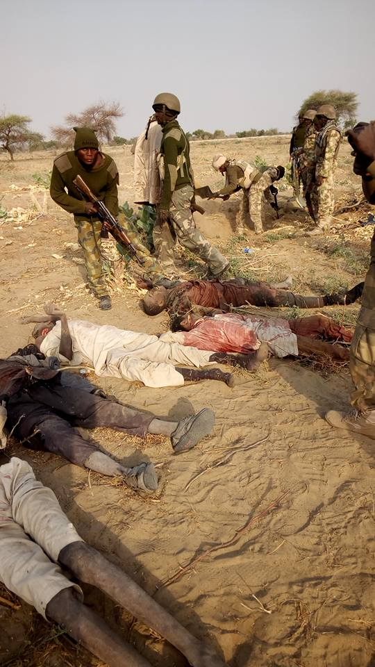 Nigerian Soldiers Pose With Dead Bodies Of Boko Haram Members After Attack In Sambisa