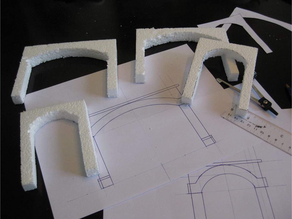 Tunnel portal templates and specifications drawn out on white copy paper with expanded foam mockups