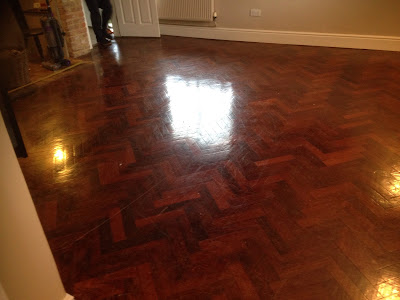 Blood red parquet floor prior to sanding