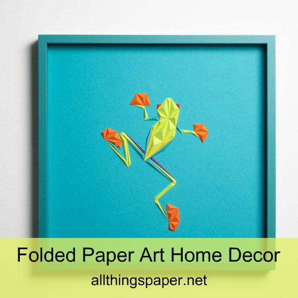 dimensional frog made of colorful folded paper triangles in square white frame on wall