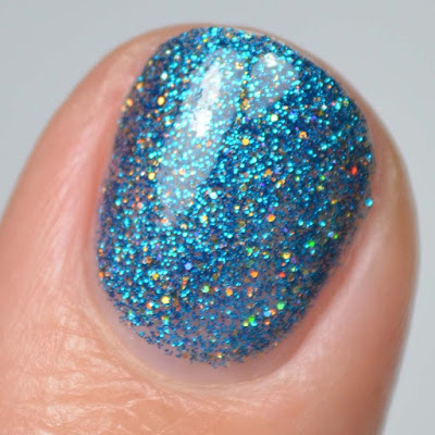 blue micro glitter and gold holographic micro glitter nail polish swatch