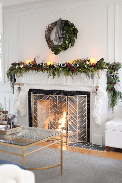 Faux cedar garland. Red and white christmas decorations. Vine and magnolia wreath. Cable knit stockings.