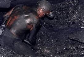 a miner with blackened skin. It was so hot that some men worked naked