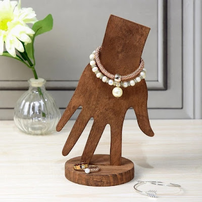 Wooden Hand Jewelry Display showcasing bracelets and rings