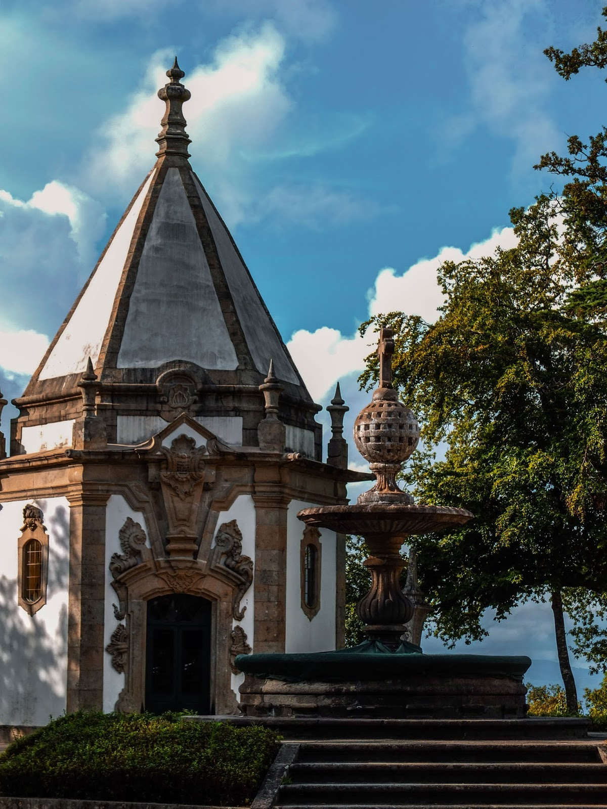 A chapel from Bom Jesus do Monte in Braga, Portugal pictured with a water fountain.