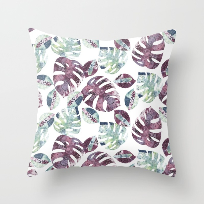 A mock up of a cushion with Kim Dellow's Cheeseplant Leaf pattern
