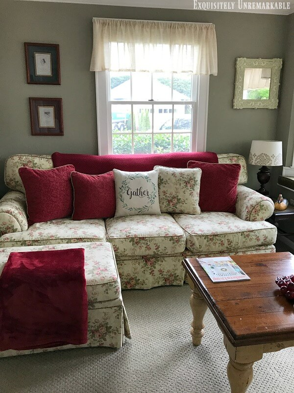 Cottage Style Floral Couch in a green family room.