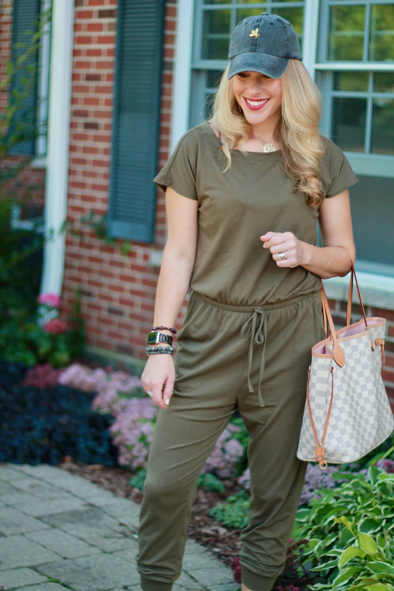 olive jumpsuit, sneakers, grey baseball hat, jumpsuit for fall