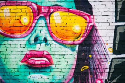 Mural of woman in pink sunglasses