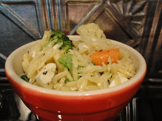 Orzo with fresh vegetables, lemon, and feta cheese
