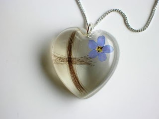 Hair formed into a cross heart shaped pendant