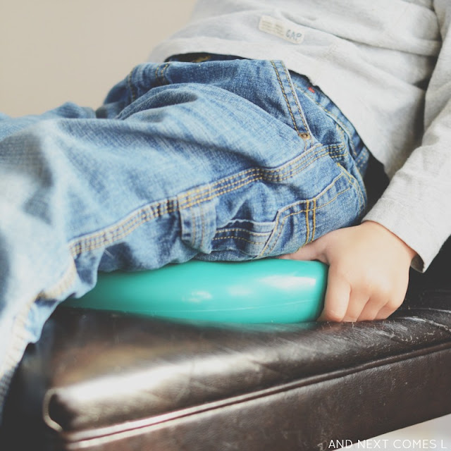 Using a balance cushion to help fidgety kids sit still during mealtimes from And Next Comes L