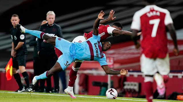 Michail Antonio and Arsenal defender Gabriel get tangled up as they both lose their balance