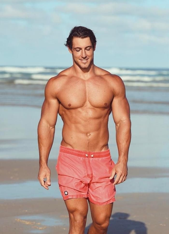 bulky-beach-handsome-hunk-tank-muscle-male-body-pecs-big-arms-beefcake-pink-shorts