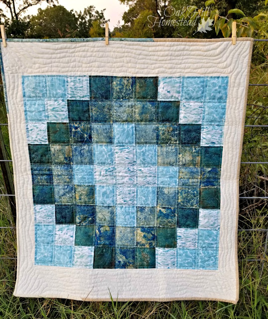 "Quilts should have names, don't you think? This crib quilt is ""Tide Pool."""