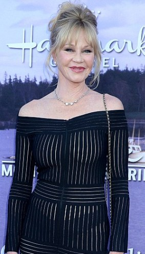 Actress Melanie Griffith, 58, goes braless in a sheer dress (photos)