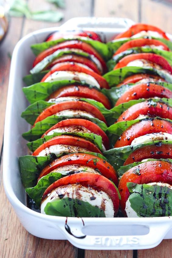 The most festive tomato mozzarella salad with balsamic reduction. Make this as an appetizer or side and you'll be the talk of the party!