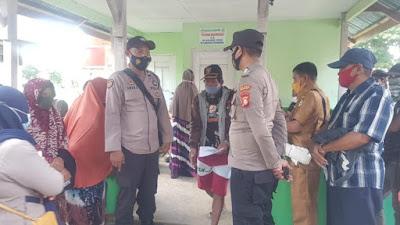 Dengan Protkes, Warga dari 14 Desa 2 Kelurahan di Pammana Kembali Terima BST