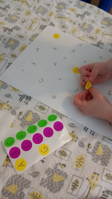 toddler practicing her letter recognition, matching the uppercase and lowercase letters