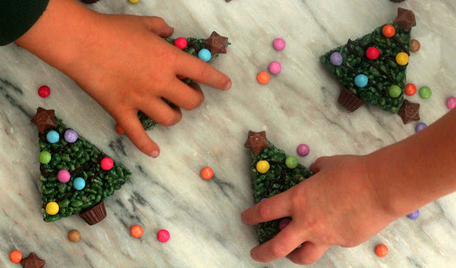 children taking marshmallow krispie christmas trees