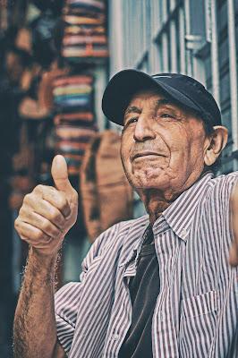image of man making 'thumbs up' symbol