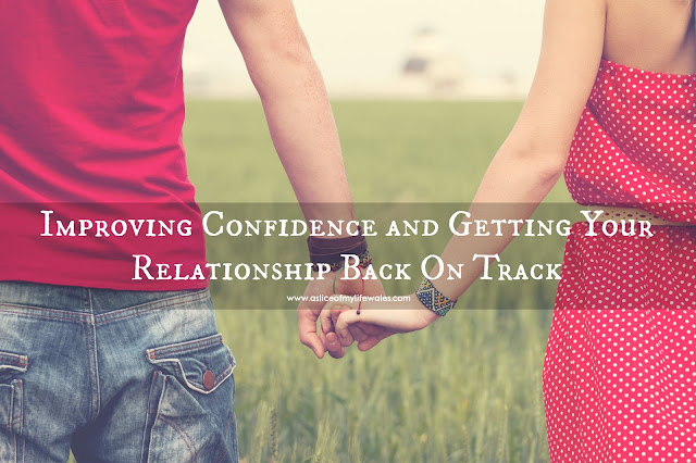 Improving Confidence and Getting Your Relationship Back On Track - couple holding hands in grassy field both wearing red